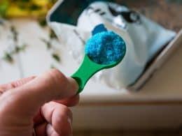 Blue plant fertilizer on a green spoon