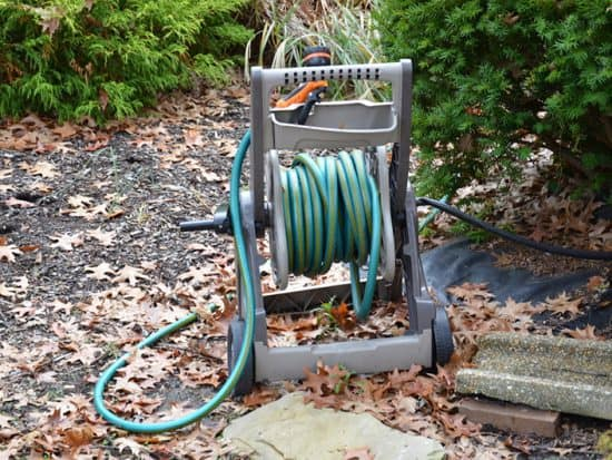 green garden hose on hose reel
